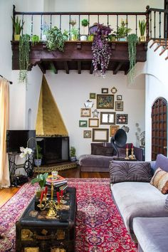 Bold hues and rich textiles offset white walls and earthy plants for a laidback ambiance. - HarpersBAZAAR.com