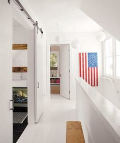 A glossy white zone in between kids' rooms is calming and refreshing.