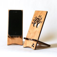 Boggles me why so many stands don't have room for charger to be plugged in while on stand - this ones does not! Wood iPhone Stand  iPhone 4 4S 5 by ideasinwood on Etsy, $25.00