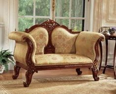 A typical ornate Victorian loveseat. It is actually more comfortable than it looks — it would almost have to be.