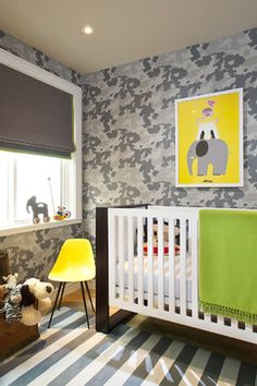 Graphic gray camouflage walls and bright yellow. So cute for a little boys nursery! - Jute Interior Design