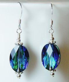 A personal favorite from my Etsy shop https://www.etsy.com/listing/164906136/stunning-swarovski-aquamarine-green