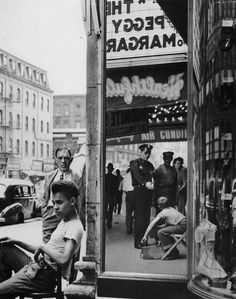 Shoe shine boy with cop on14th st, 1947, Arthur Leipzig. American, born in 1918.
