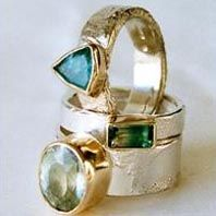 Hand made silver and 9ct gold stone set rings by Susanna Hanl available at…