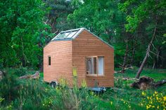 Marjolein's tiny house has cutting edge, almost futuristic styling, with unusual angles and lots of large windows, but it still looks right at home in a forest clearing filled with . Read moreTrue off-grid living in a stylish Dutch tiny house Off Grid Tiny House, Modern Tiny House, Tiny House Design, Tiny House On Wheels, Tiny House France, Normal House, Balustrades, Tiny House Builders, Wale