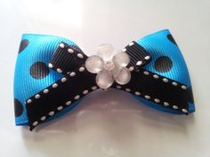 Blue bow with black polka dots and a white flower by BlackHeartAcc