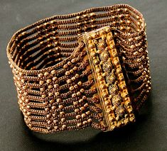 Bracelet of finely woven hair accented with gold beads and clasp, before 1850. Probably one of a pair that would have been worn as matched cuffs.