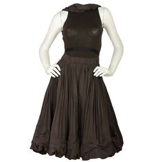 DONNA KARAN Brown Pleated Dress W/ Attached Belt sz. 2   From a collection of rare vintage day dresses at https://www.1stdibs.com/fashion/clothing/day-dresses/