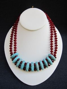 """ONDINE    ~ 1"""" Turquoise Links  ~ 8mm Faceted Burgundy Crystal Rondelles  ~ 7mm Faceted Red Cyrstal Rondelles    19 1/2"""" Round  Brass Toggle Closure  $248.00...love the red and turquoise"""