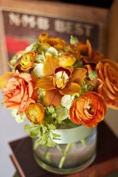 Flower ideas for one of our brides! Love the orange tones and textures of the bouquet.