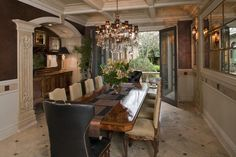 Too much bling in the dining room of this italiante villa but generally like it especially the giant doors.