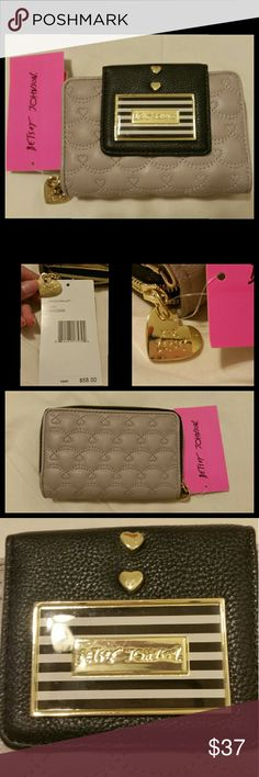 1 WEEK LEFT! NWT Betsey Johnson wallet GONE IN 1 WEEK! NOT AVAILABLE AFTER MONDAY FEB. 13!  PRICE IS FIRM!  This adorable wallet features a gray-ish lilac body w/quilted heart pattern and magnetic button closure on the front to hold the black flap closed. Flap has 2 hearts and Betsey Johnson metal plaque.  Inside the fold is a great place to stash cash and credit cards.  It has a zipper compartment for change!  All metal is gold tone.  Zipper has heart with XOX Betsey on it.  NWT.  PRICE IS…