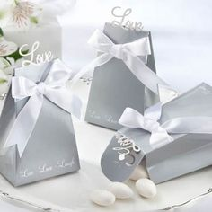 For your elegant wedding, choose these silver love favor boxes. Each silver, wedge-shaped box has a die-cut Love that pops up when assembled.