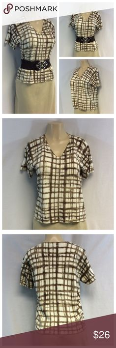 """LIZ CLAIBORNE ABSTRACT DESIGN TOP LIZ CLAIBORNE Abstract Design Top, Size M, 100% cotton, machine wash. Approximate measurements are 17"""" shoulder seam to shoulder seam, 20"""" bust laying flat, 21 1/2"""" shoulder to hem, 7"""" sleeve from shoulder to end of sleeve. 0169 Belt not included. Liz Claiborne Tops"""