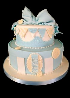 Blue bow and bunting christening cake