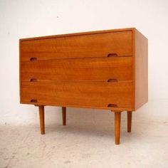 Robin Day; Walnut and Satin Wood Chest of Drawers by Hille for Heal's, 1950s.