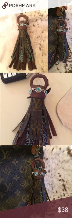"Authentic upcycled Louis Vuitton canvas tassel This is a Faith and Fringe tassel that can be used as a keychain or purse charm. It measures 8 1/5"" in total length. It was made from authentic Louis Vuitton canvas from a damaged Sac. It has brown leather, turquoise and brown embossed leather, and brown leather. It has a large lobster clasp and large statement piece.  Contact me for custom orders!! Like us on Facebook Faith and Fringe Available on Etsy for $28 FaithandFringe Louis Vuitton…"
