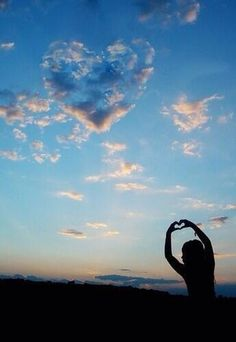 I heart you hands and an heart shaped clouds in blue sky