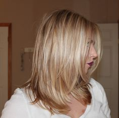 Sam Schuerman: MY NEW HAIR! Side  profile...medium/long layers, face framing layers and blunt across bottom. LOVE.