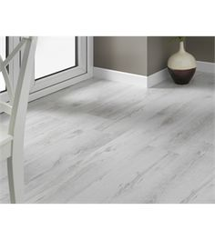 White wood-look flooring is great for mixing traditionalism with modern minimalism.