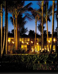 A soft breeze blows in from your private lanai, tousling the gauzy fabric draped from your bamboo canopy bed. You wake up with difficult decisions to make: a soak in the deep granite tub or an alfresco shower in your private lava rock garden? A dip with tropical fish in the sand-bottomed swimming hole or in the oceanfront infinity pool amid gardenia and swaying palms? Haute locavore fare at 'ULU Ocean Grill, which works with 160 island farmers, or feet-in-the-sand mai tais and mahimahi tacos…
