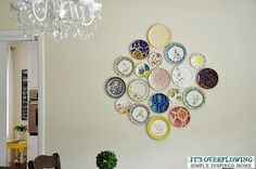 "How to decorate a wall with a collection of plates using ""invisible English Disk Adhesives"""