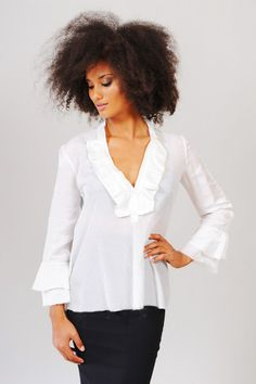820c1d48957 The Tuscany blouse is an elegant SITA Couture classic. It features ¾ length  ruffled sleeves and a ruffled neckline. This blouse is flirty