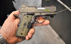 New for Kimber exhibited dozens of small frame Micro and well-equipped Aegis Elite and KHX pistols at SHOT Show in Las Vegas last month. Weapons Guns, Guns And Ammo, Kimber Micro, Shot Show, Custom Guns, Hunting Guns, Leather Holster, Cool Guns, Firearms