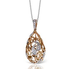 Simons Gold Collection - This fabulous 18K white and rose gold pendant is comprised of .20ctw round white Diamonds. - MP1676 Timeless design for the modern woman. Try it on today at SVS Fine Jewelry 2947 Long Beach Rd. Oceanside NY 11572 or call (516) 766-2614 for more details.