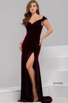 Beautiful floor length form fitting burgundy velvet prom gown features off the shoulder cap sleeve v neckline and high slit.