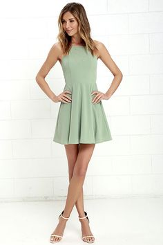 Prepare to sweep all your sweethearts off their feet with the Call to Charms Sage Green Skater Dress! Sleek woven poly shapes an apron neckline and seamed bodice atop a flaring skater skirt. Skinny straps meet with a racerback for a chic finishing touch. Hidden back zipper/hook clasp.