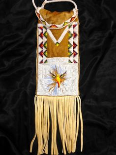 A one of a kind, beaded equestrian bag made by the famous and master beadworker, Debra Lee Stone, Western Shoshone & Piaute Tribes. (signed by artist) Size 11 cut beads sewn on brain tanned natural smoked brain tanned buckskin, beaded handle. Bag is 23 1/2 long and 9 wide, the fringe is 10 in length.$1,500.00 plus postage and handling fee.Give us a call! 208-238-7551 or buy on Etsy: https://www.etsy.com/shop/BeadworkMasterPieces?ref=hdr Select items from our current inventory offered for…