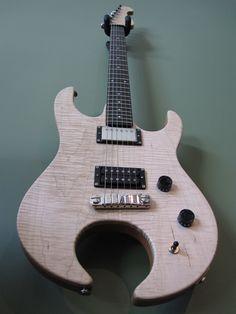 Custom guitar by Chelsea Ira. Alder body with maple top. Maple neck, ebony fretboard. Custom shape