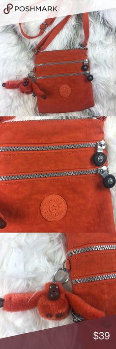 REDUCED Kipling messenger crossbody bag Kipling messenger crossbody bag color is like a tangerine orange small Kipling Bags Crossbody Bags