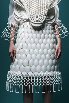 BEEING HUMAN by JAMELA LAW, graduate FASHION DESIGN & TEXILES BA HONS LASALLE COLLEGE OF THE ARTS- Bees collect nectar to make strong, systematic and nurturing structures, similar to how human construct object for protection, be it clothing or architecture. The fusion of 3D printed geometric, architectural and biological forms coming together on a human body ..See all the 20 shortlist https://www.artsthread.com/competitions/wgsnartsthreadfuturecreatorawardhongkong/