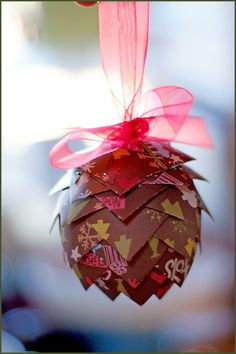 Make Paper Pinecones for every season as a cute decoration.  Scrapbooking paper in any theme would work.