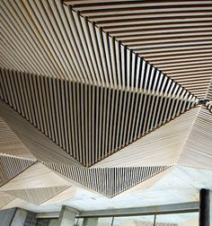 A wooden origami-inspired ceiling made of pine. The existing office of Melbourne-based Assemble studio was largely open and made of concrete, leading to terrible acoustics and ample echoing. To combat this issue Assemble's designers created their own riveted installation.
