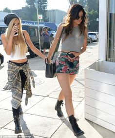 Girls' day out: The sisters were joined by a friend for their shopping trip in LA on Saturday