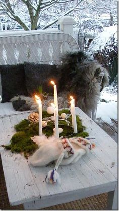 cozy mittens, fir boughts, candles. How romantic!