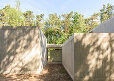Concrete boxes form Belgian woodland home by Sculp IT
