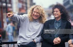 Photo of Jimmy PAGE and PLANT & PAGE and Robert PLANT and PAGE & PLANT; Page & Plant - Robert Plant & Jimmy Page of Led Zeppelin posed outside Camden Tube