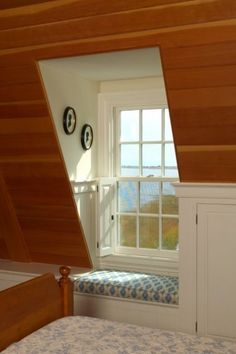 Pine tongue and groove ceiling in a dormer / attic bedroom. Built in reading bench.