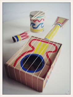 """Fun to make instruments and have an """"orchestra"""" play at the end of the year in class! cool diy guitar + musical instruments for kids Kids Crafts, Projects For Kids, Diy For Kids, Arts And Crafts, Homemade Instruments, Music Instruments Diy, Music For Kids, Art Plastique, Diy Toys"""