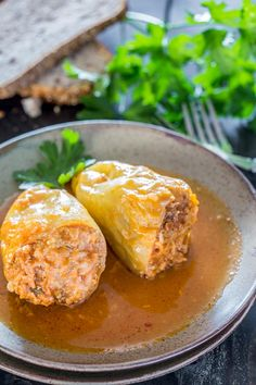 Traditional Romanian style stuffed peppers, loaded with a mix of ground pork and rice, served with sour cream.