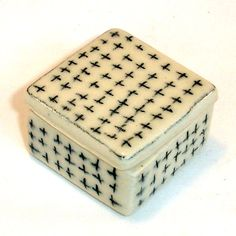 tiny porcelain box + black criss-cross in underglaze pencil