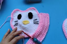 """Crochet Childs' Purse Inspired by """"Hello Kitty"""" Pattern by: Yolanda Soto Lopez Materials Hook G/6 4.25 Hook I/ 9 5.5mm Medium weight (4weight) Acrylic yarn in the following colors; White (110yards) Lt. Pink (about 30 yards) Scraps of yellow yarn Scraps of black yarn Stitch markers Scissors Stitches used: single crochet and half double crochet. …"""