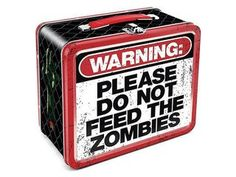 """Keep your lunch ready for a zombie attack! This Zombie Warning Tin Tote Lunch Box features a cool warning sign that states, """"Please do not feed the zombies."""
