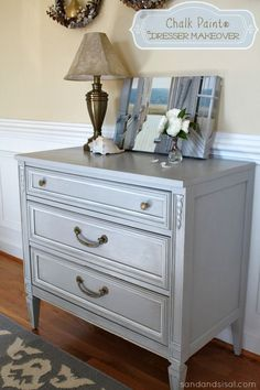 This 1970's childhood dresser was given a gorgeous makeover by Sand & Sisal using Paris Grey & Pure White Chalk Paint® decorative paint by Annie Sloan!