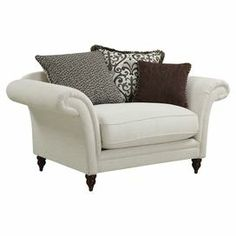 Curl up with a good book in this oversized armchair, a classic addition to your living room or library.