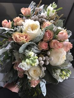White and blush hand tied bouquet featuring dusty miller and Garden roses. Designed by Eden Events